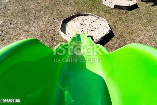 656743520 istock photo Green slide pov on the playground 936894188