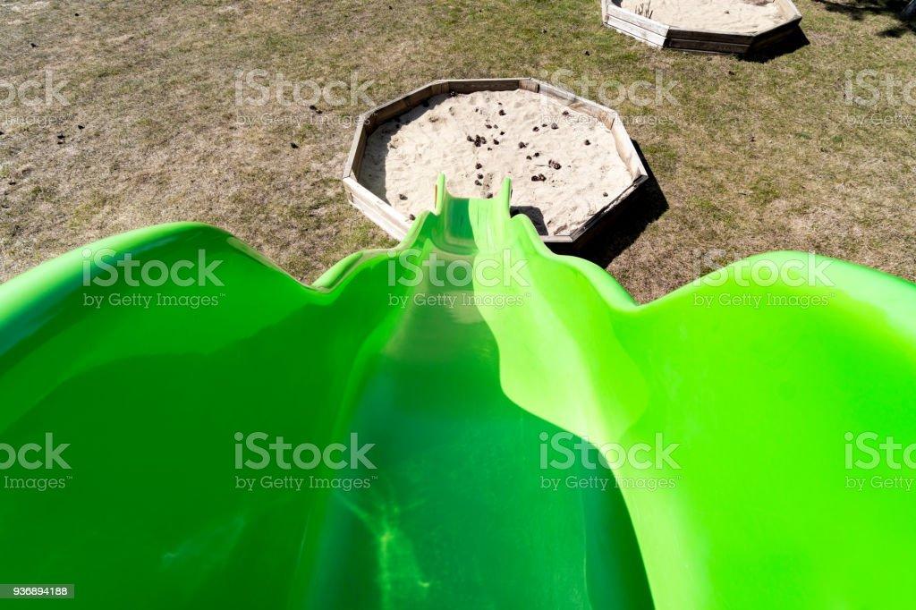 Green slide pov on the playground stock photo