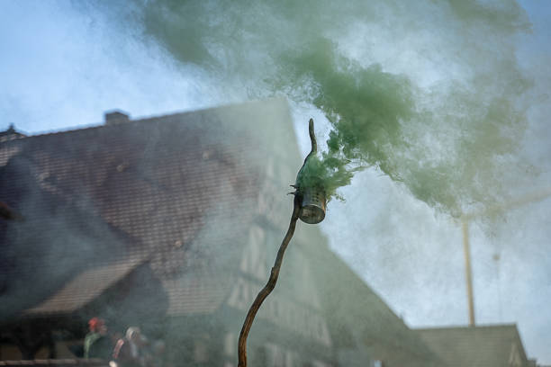 green smoke at a carnival event in the blue sky stock photo