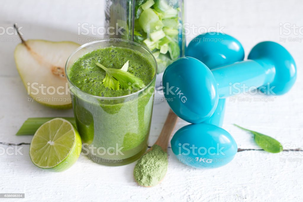 Green smoothie and dumbbells health diet lifestyle stock photo