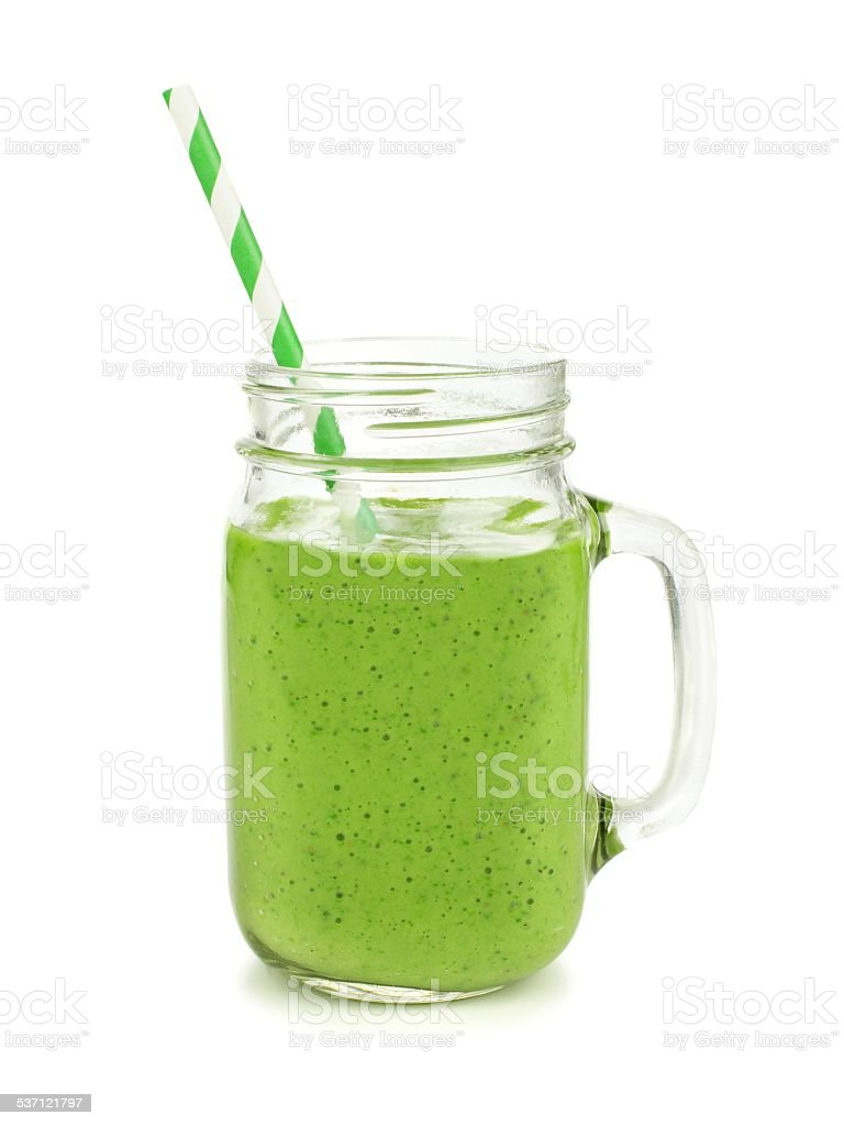 Green smoothie in a jar mug isolated stock photo