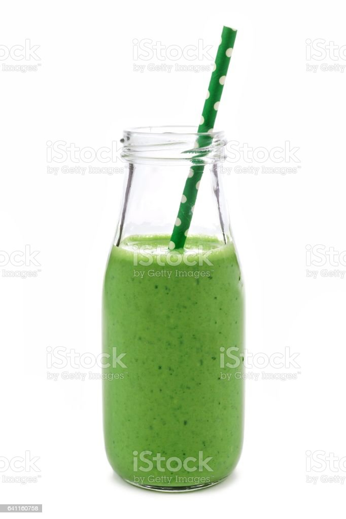 Green smoothie in a milk bottle isolated on white stock photo