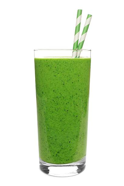 green smoothie in glass with straws isolated on white - yeşil renk stok fotoğraflar ve resimler
