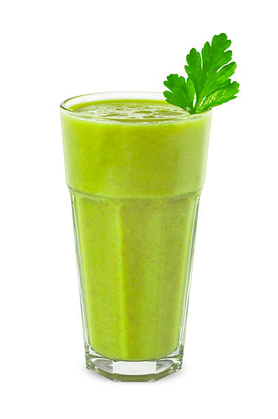 Green smoothie in tall glass with mint leaf Green smoothie made of green vegetables. vegetable juice stock pictures, royalty-free photos & images