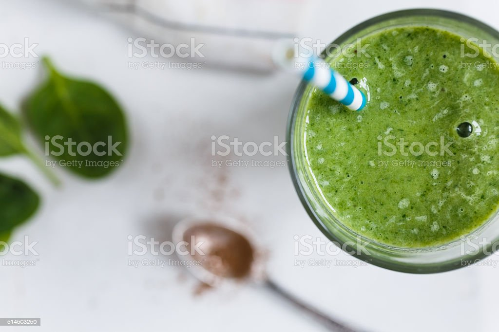Green smoothie in the glass stock photo