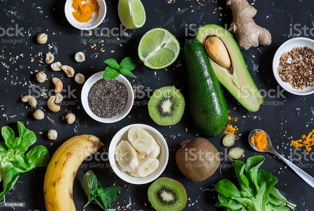 Green smoothie ingredients. Cooking healthy detox smoothies. stock photo