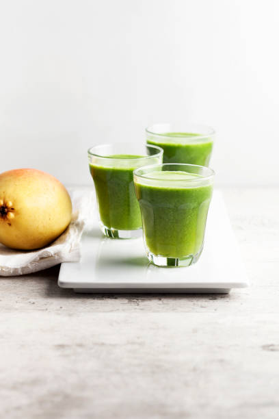 Green smoothie Green smoothie vegetable juice stock pictures, royalty-free photos & images