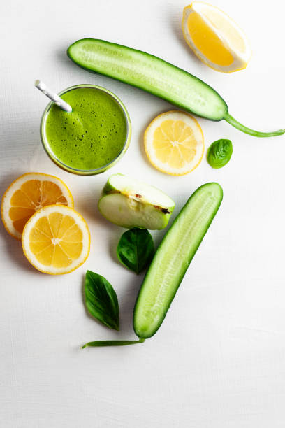 Green Smoothie with Antioxidants, Fresh Fruit Juice Drink in Glass, Cucumber, Orange - Fruit, Smoothie, Juice Bar, Antioxidant vegetable juice stock pictures, royalty-free photos & images