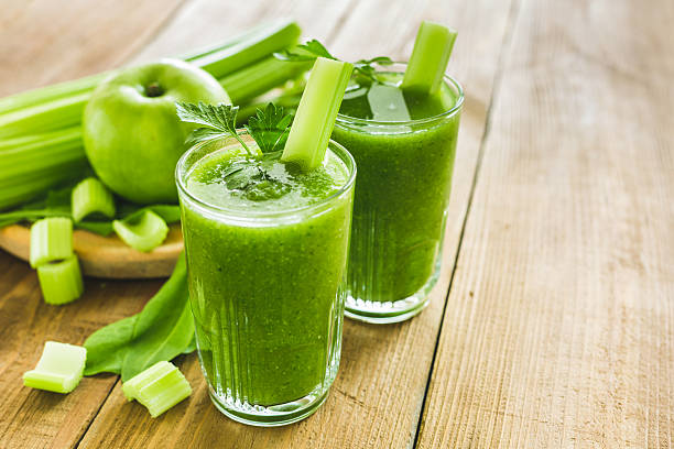 Green smoothie with celery, spinach and apple stock photo