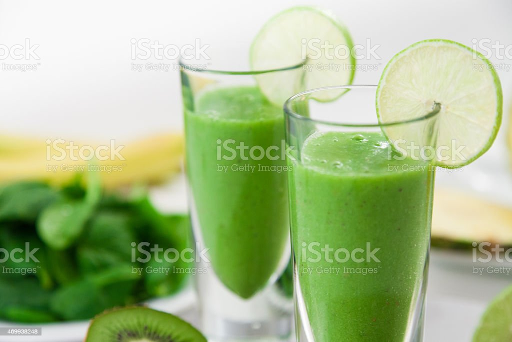 Green Smoothie with Fruits in Background stock photo