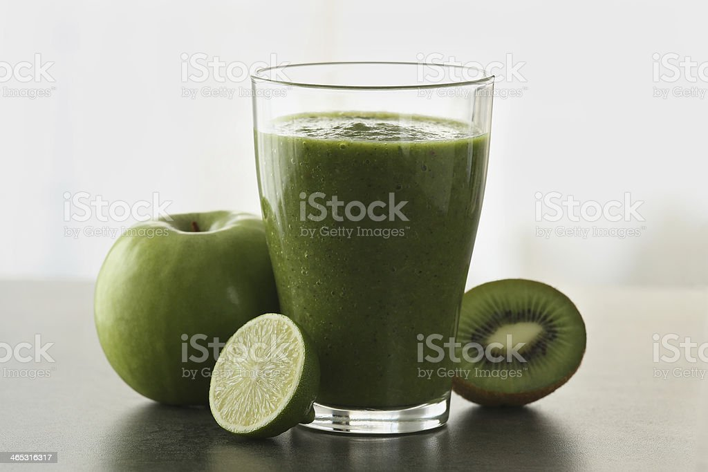 Green smoothie with fruits stock photo