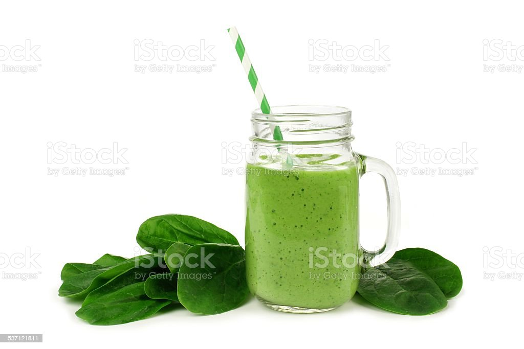 Green smoothie with spinach isolated stock photo