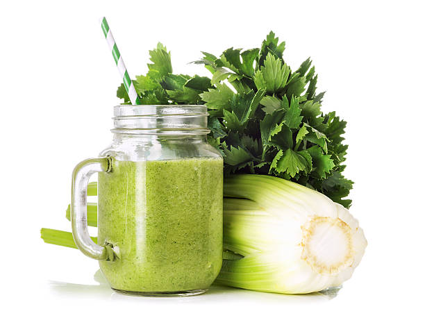 Green smoothies in a glass jar stock photo