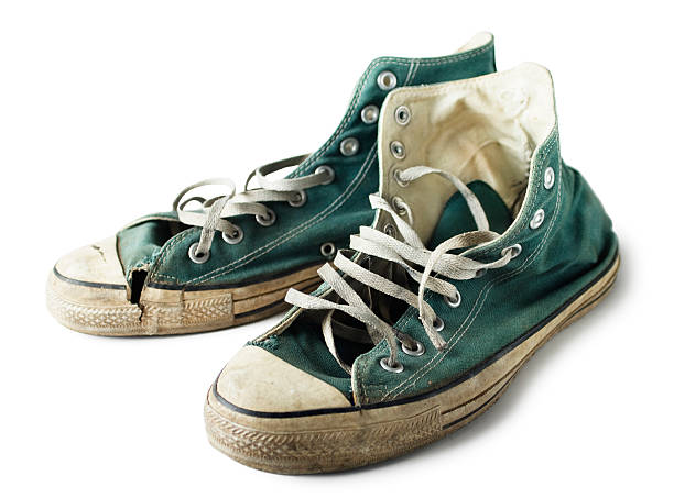 green sneakers - dirty shoes stock photos and pictures