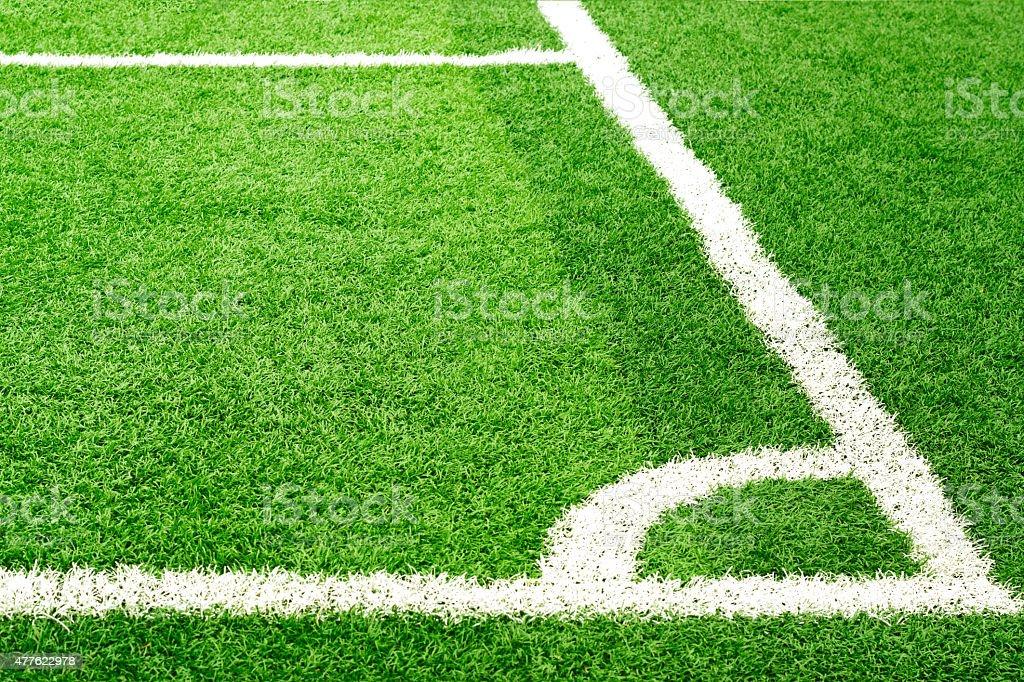 Green soccer field grass and white corner line stock photo