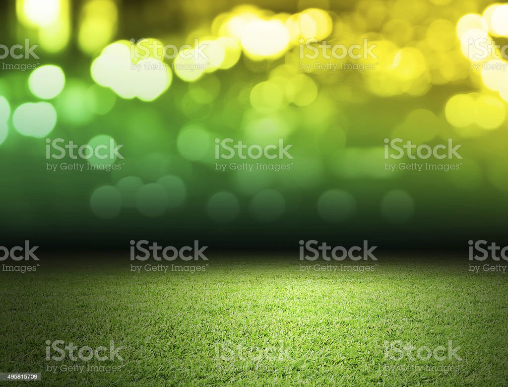 Green soccer field with bokeh backdrop stock photo
