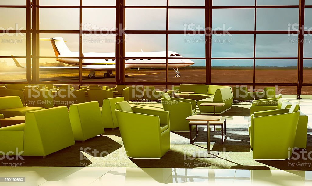 Green sofa on the luxury airport lobby stock photo
