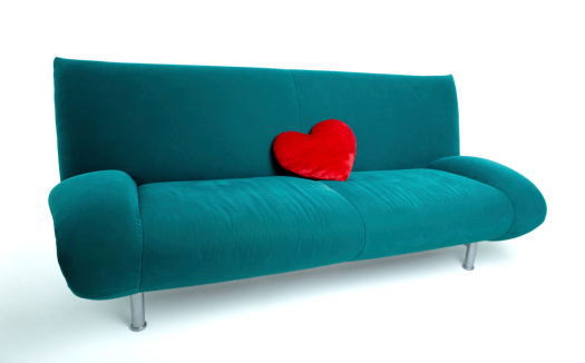 Green sofa with red heart