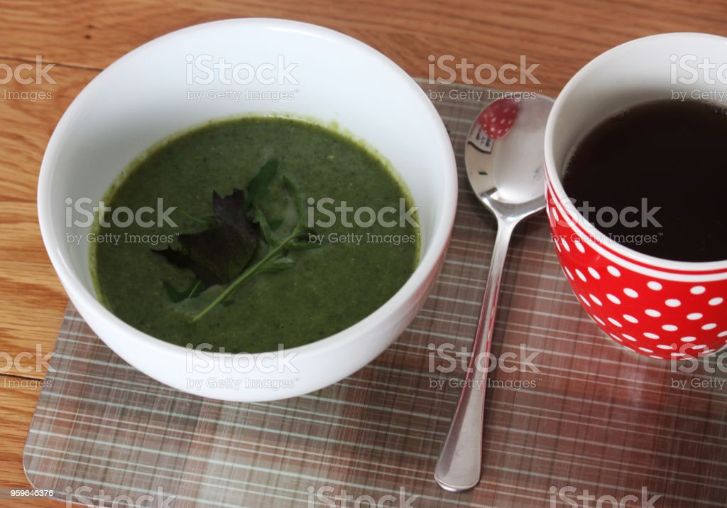 Green Soup in a white bowl stock photo