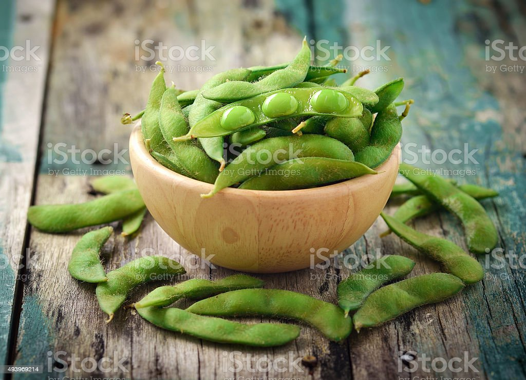 green soy beans in the wood bowl on table stock photo
