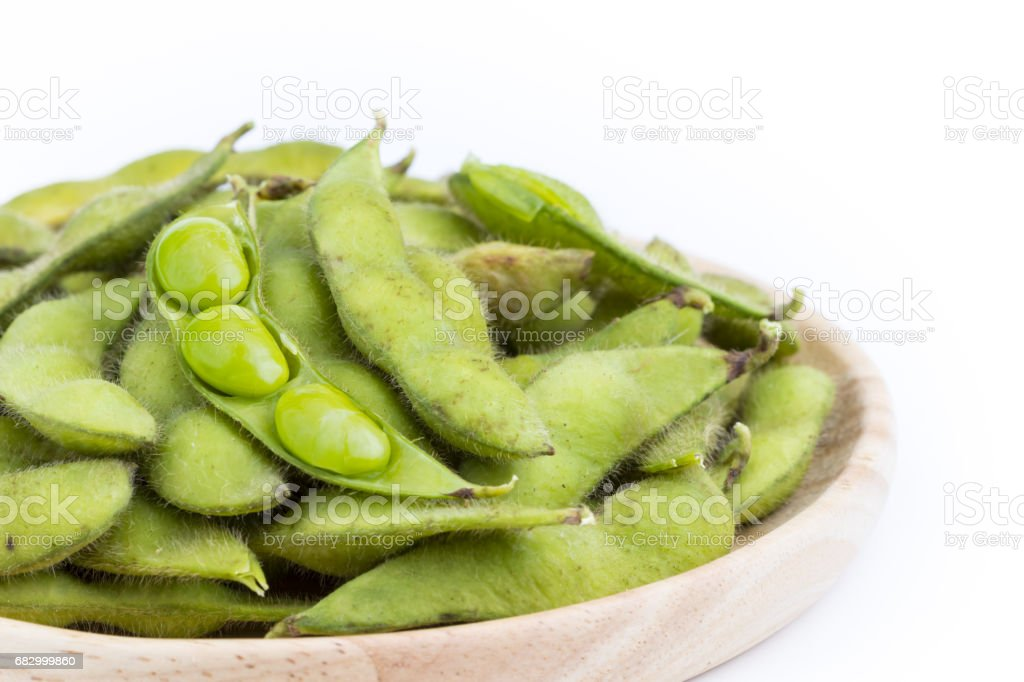 Green soybean with seeds (Vegetable soybean) boiled in wooden plate on white royalty-free stock photo