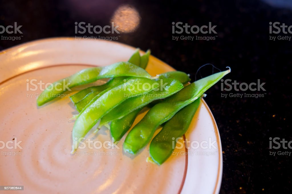 Green soybeans edamame japanese snack on plate Green soybeans edamame japanese snack on plate Appetizer Stock Photo