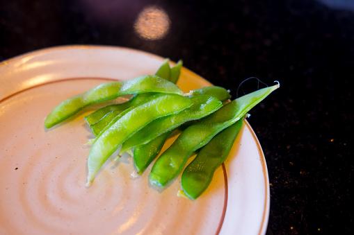 Green Soybeans Edamame Japanese Snack On Plate Stock Photo - Download Image Now
