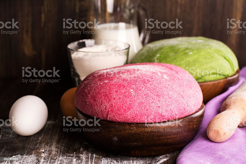 Green spinach and pink beet dough stock photo