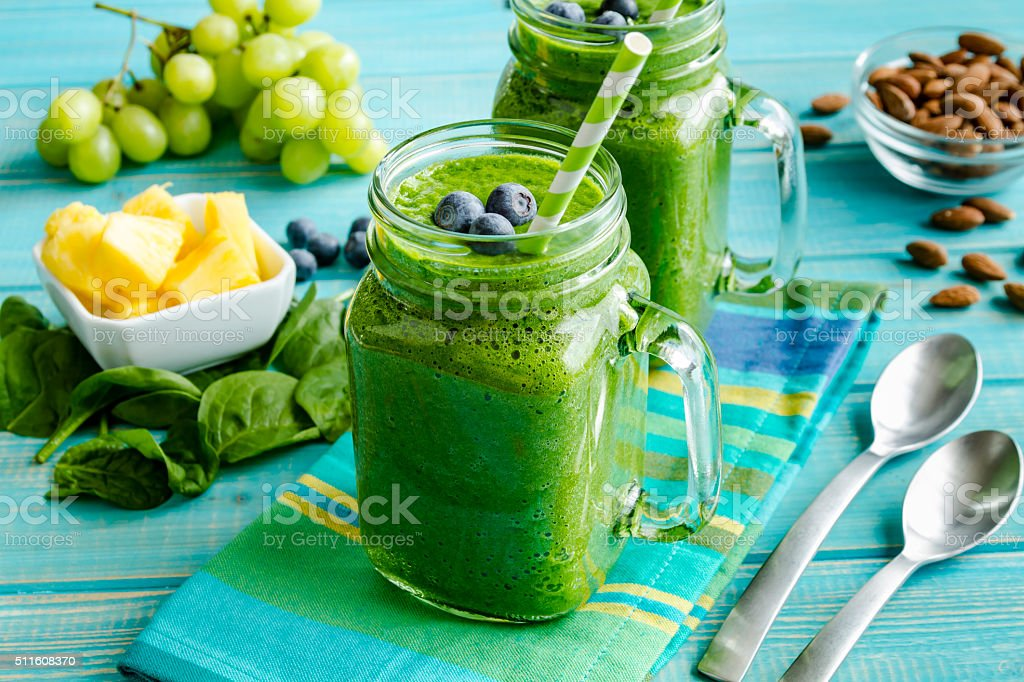 Green Spinach Kale Detox Smoothie stock photo