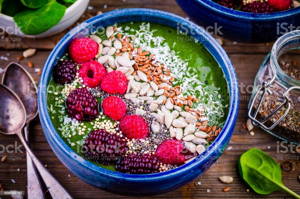 Green spinach smoothie bowl with raspberry royalty-free stock photo