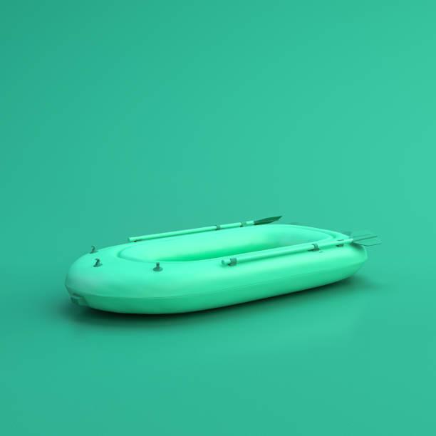 grön sportutrustning uppblåsbar båt på grön bakgrund, solid bakgrund, platt bakgrund, enda färg, 3d-rendering - livbåt bildbanksfoton och bilder
