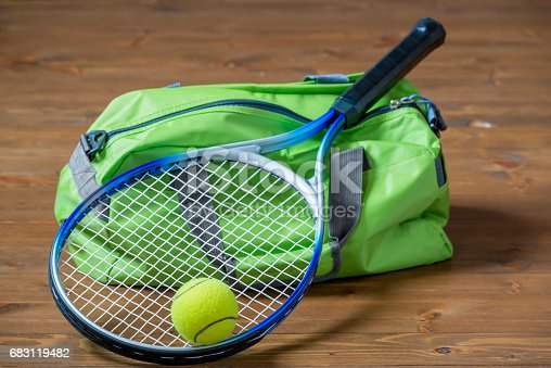istock Green sports bag and a racket for a game of tennis close-up on the floor 683119482
