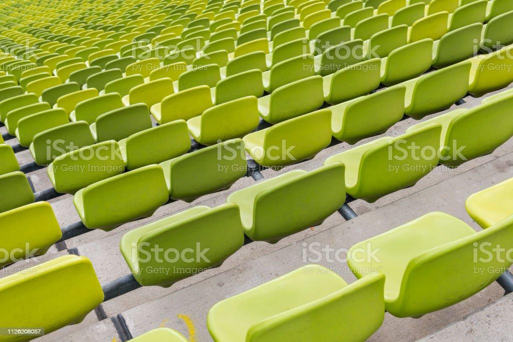 green stadium seats stock photo