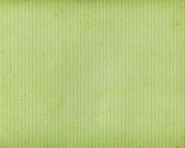 green stained paper with vertical lines stock photo