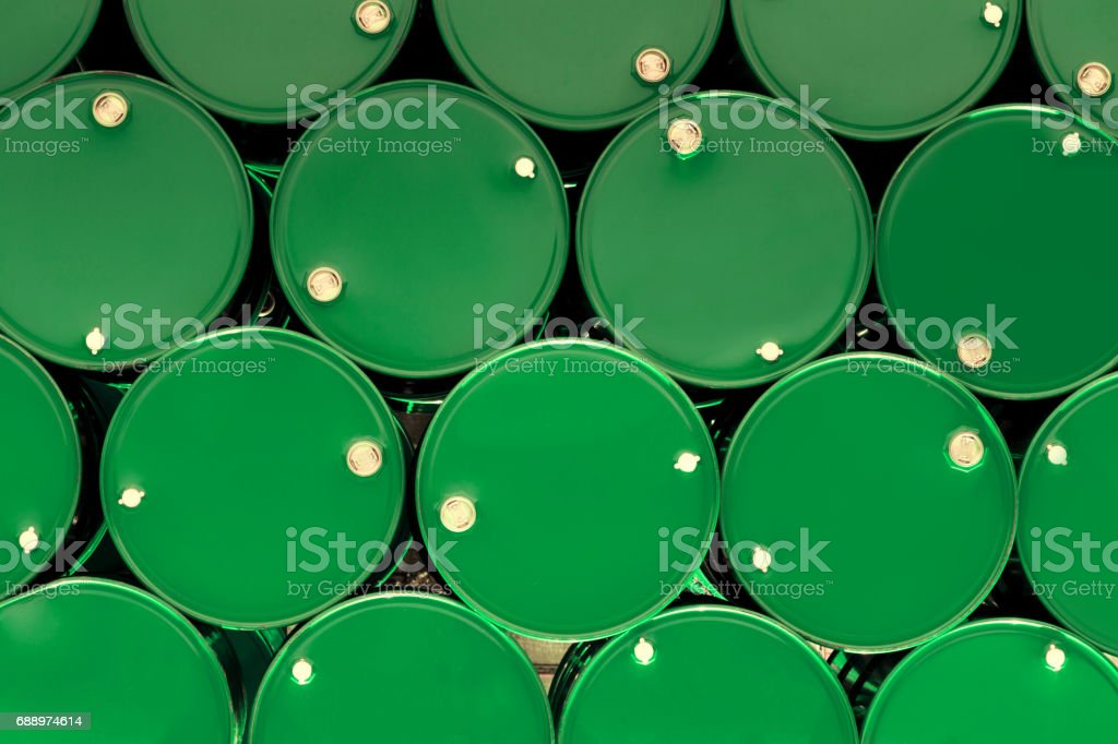 green steel chemical tanks or oil tanks stacked in a row. background...