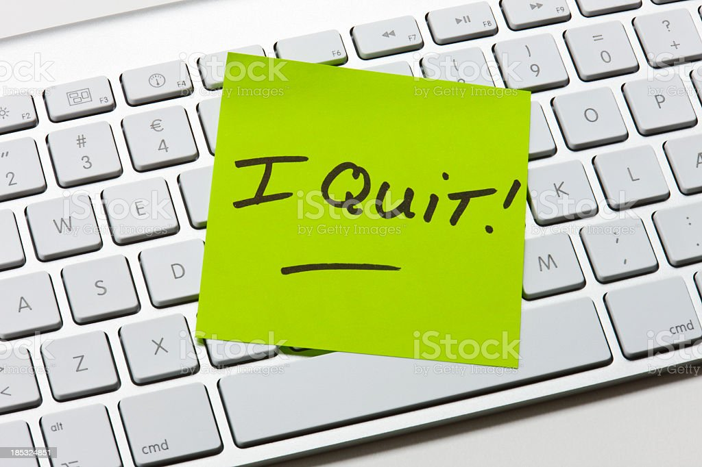 A green sticky note of resignation stock photo