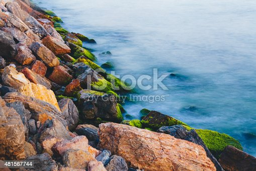 istock Green stones in the surf 481567744