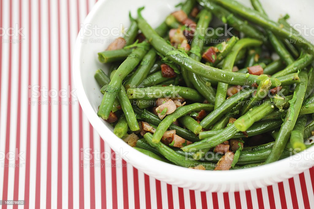 Green string beans salad with ham and vinaigrette stock photo