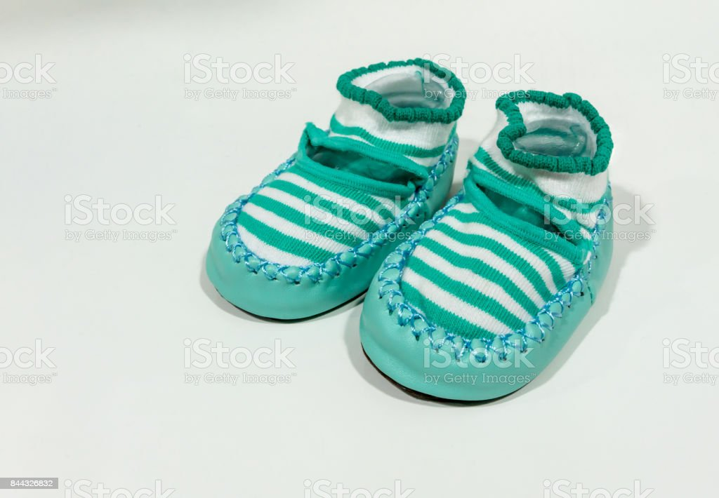 Green stripe fabric shoe with leather zig zag stitched along the edge. stock photo