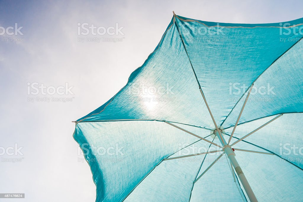 Green sun umbrella stock photo