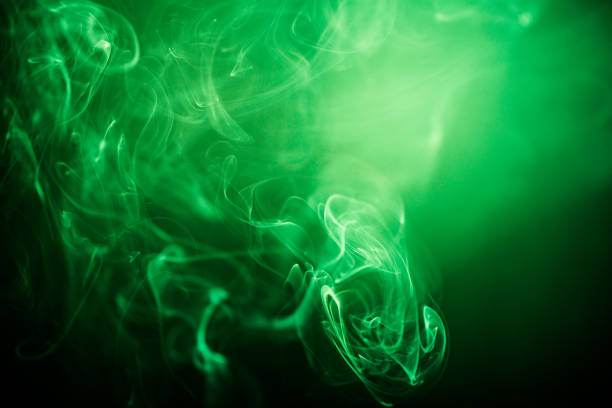 green swirling smoke abstract close up on black background - poisonous stock pictures, royalty-free photos & images