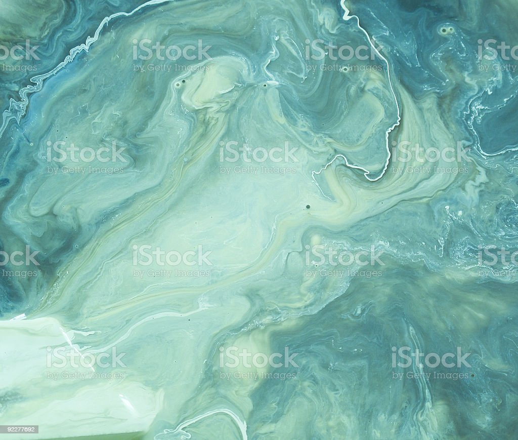Green swirls of paint stock photo
