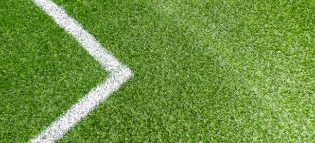 green synthetic grass soccer sports field with white corner stripe line - soccer competition stock photos and pictures