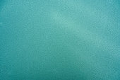Texture green synthetic rubber field of tennis court background