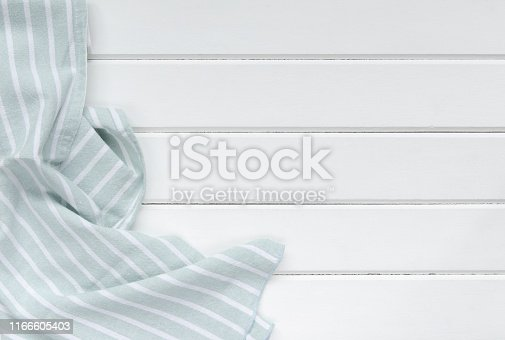 Green tablecloth on white wooden