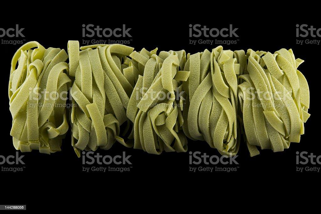 Green tagliatelle pasta rolls royalty-free stock photo