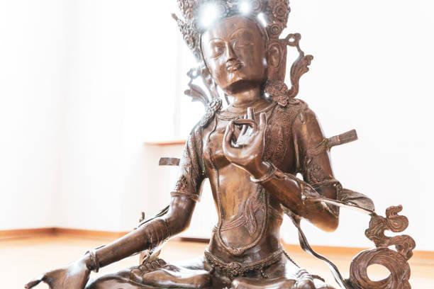 Green Tara. Buddha statue. Buddhism symbol of religion, peace and spirituality. stock photo