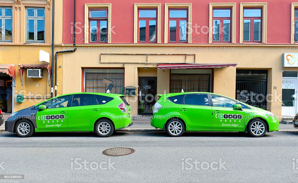 Green Taxi Cars - Photo