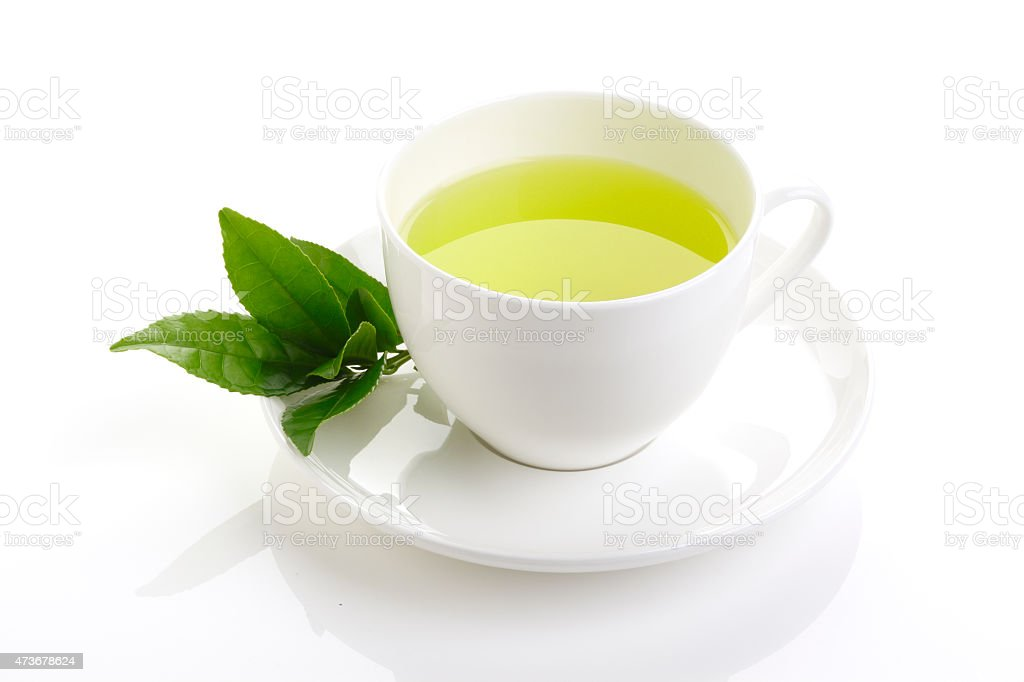green tea and fresh green tea leaves stock photo