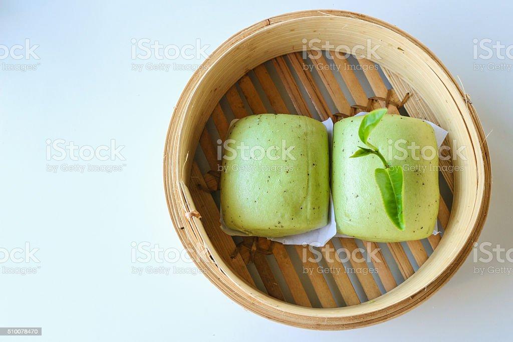 Green tea buns in bamboo basket stock photo